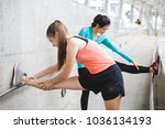 sportswomen stretching after... | Shutterstock . vector #1036134193