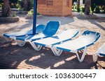 sun loungers and beach... | Shutterstock . vector #1036300447