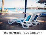 sun loungers and beach... | Shutterstock . vector #1036301047