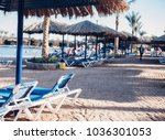 sun loungers and beach... | Shutterstock . vector #1036301053
