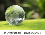crystal globe on a glass in a... | Shutterstock . vector #1036301437