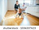 couple sitting on the floor in... | Shutterstock . vector #1036337623
