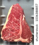 Small photo of Top view of a raw fresh prime quality T-bone beef steak. Agnus Aberdeen t bone or porterhouse aged steak.