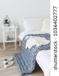 bed with white linen and grey... | Shutterstock . vector #1036402777