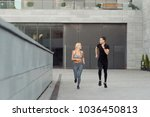 friends jogging in the city.... | Shutterstock . vector #1036450813