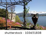 spectacular view from historic Garden of Villa Carlotta of lake Como and snow mountains on horizon, Tremezzo,Milano, Lombardy, Italy, Europe - stock photo