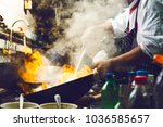 Small photo of Chef is stirring vegetables in wok