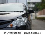 focusing on the black car... | Shutterstock . vector #1036588687