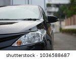 focusing on the black car... | Shutterstock . vector #1036588687