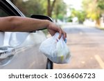 man's hand throwing trash out... | Shutterstock . vector #1036606723
