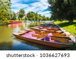 A Row Of Punts On A Bright...