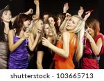 A group of young beautiful people dancing at a disco. - stock photo