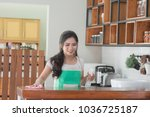 a happy housewife woman in the... | Shutterstock . vector #1036725187