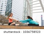 sportswomen stretching after... | Shutterstock . vector #1036758523
