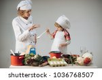mother teaches son to cook on... | Shutterstock . vector #1036768507