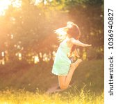 happy girl in the rays | Shutterstock . vector #1036940827