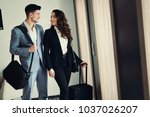 couple at a hotel lobby hall ... | Shutterstock . vector #1037026207
