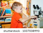 a boy of 6 7 years old in an... | Shutterstock . vector #1037038993