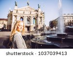 a young girl stands at the... | Shutterstock . vector #1037039413