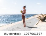 view from behind of foxy young... | Shutterstock . vector #1037061937