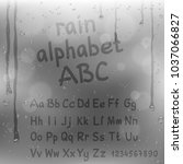 finger draw alphabet on rain... | Shutterstock .eps vector #1037066827