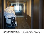 room maids trolley at a hotel | Shutterstock . vector #1037087677