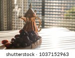 ramadhan text with dates fruit... | Shutterstock . vector #1037152963