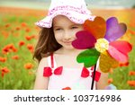 Cute child girl in poppy field - stock photo