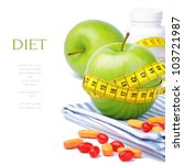 Green apples, vitamins and measuring tape. Diet concept - stock photo