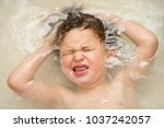 a boy looks upset with his eyes ... | Shutterstock . vector #1037242057