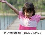 asian kids cute little girl | Shutterstock . vector #1037242423