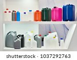 empty colorful plastic cans for ... | Shutterstock . vector #1037292763