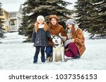 children sit in the snow and... | Shutterstock . vector #1037356153