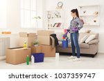 new home cleaning. young woman... | Shutterstock . vector #1037359747
