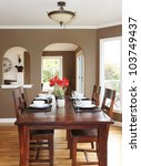Dining room with brown walls and wood table in the luxury home. - stock photo