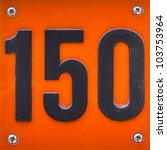 house number hundred and fifty. Black lettering on a plastic orange plate - stock photo