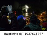 Small photo of Fireworks of Valdivian night ( Noche Valdiviana) and crowd of people in Valdivia town, Chile, South America