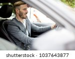 young businessman driving in... | Shutterstock . vector #1037643877