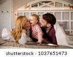 young family having fun on the... | Shutterstock . vector #1037651473