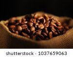 jute bag with coffee beans | Shutterstock . vector #1037659063