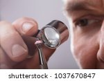 close up of a person's hand... | Shutterstock . vector #1037670847