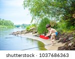 baby boy playing with ship toy... | Shutterstock . vector #1037686363