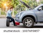 man call examining a broken car ... | Shutterstock . vector #1037693857