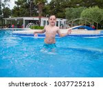 little boy having fun playing... | Shutterstock . vector #1037725213