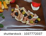 salad of cold cuts with olive ... | Shutterstock . vector #1037772037