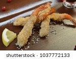 shrimp fried in breadcrumbs.... | Shutterstock . vector #1037772133
