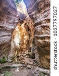 stuck hanging stone in avakas... | Shutterstock . vector #1037797027