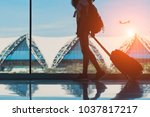 silhouette woman travel with... | Shutterstock . vector #1037817217