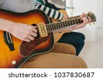 learning to play the guitar.... | Shutterstock . vector #1037830687
