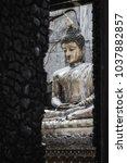 closeup shot at budha statue in ...   Shutterstock . vector #1037882857